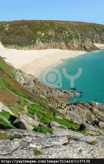Scenic view from the cliffs above Porthcurno beach, Cornwall UK.