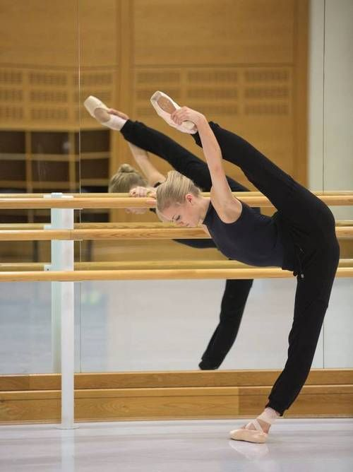 DANCE -         Ballerina exercizing at the barre... Impressive angles...