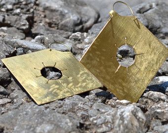 Large textured brass earrings. Remind me of something ancient