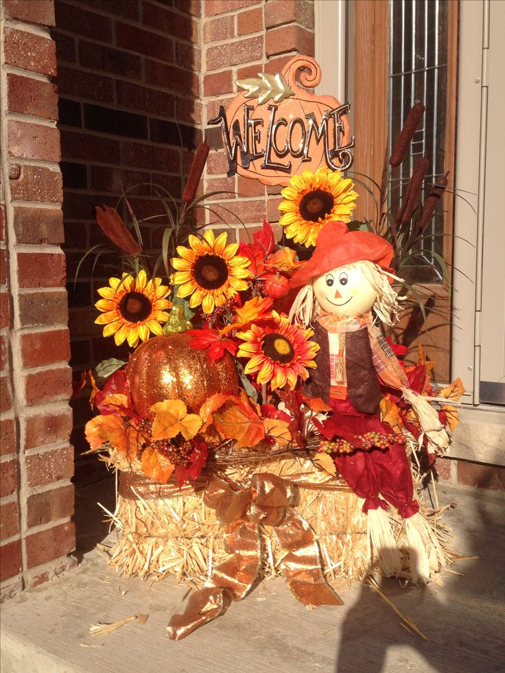 Fall decorations; scarecrow; hay bale; autumn