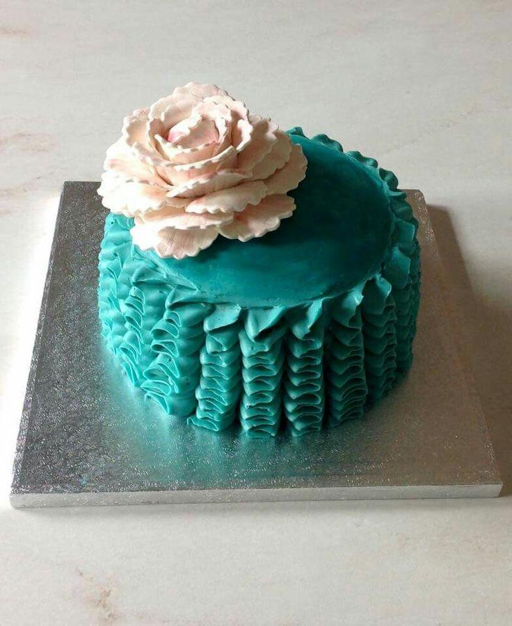 Aqua ruffles and peony cake