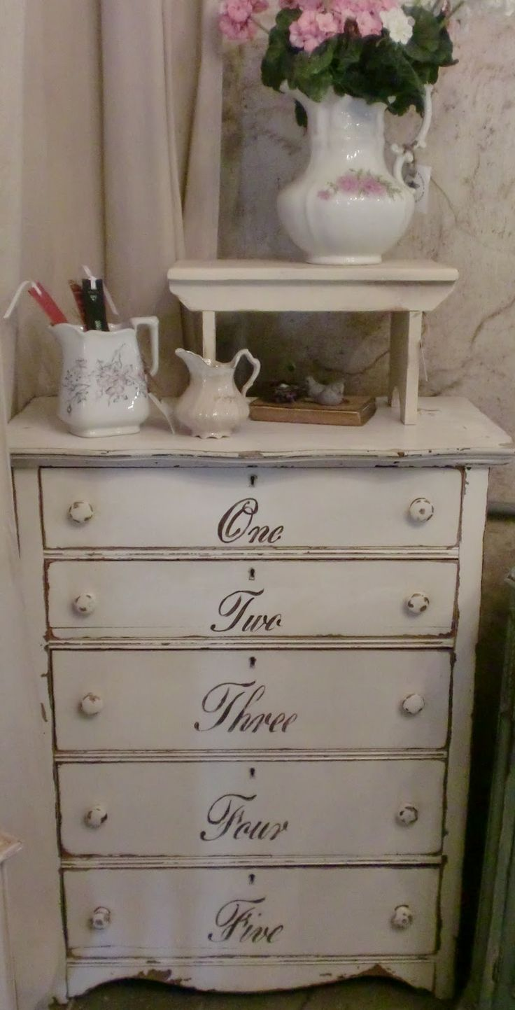 Sweet Shabby Chic Dresser...with script writing on the drawers.