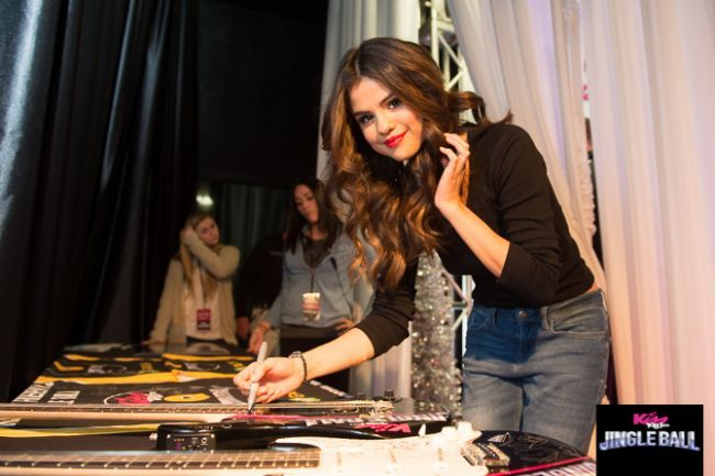 Selena Gomez @ the KISS 108's Jingle Ball presented by Market Basket at TD Garden in Boston on December 14, 2013. Signing guitars by Brand O' Guitar Company.