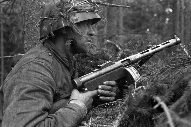 Battle tested-looking Finnish infantryman, with his K31 Suomi sub-machine gun, on alert for the enemy-- the Red Army's 23rd Corps. Battle of Vuoslami, 4-18 July 1944.