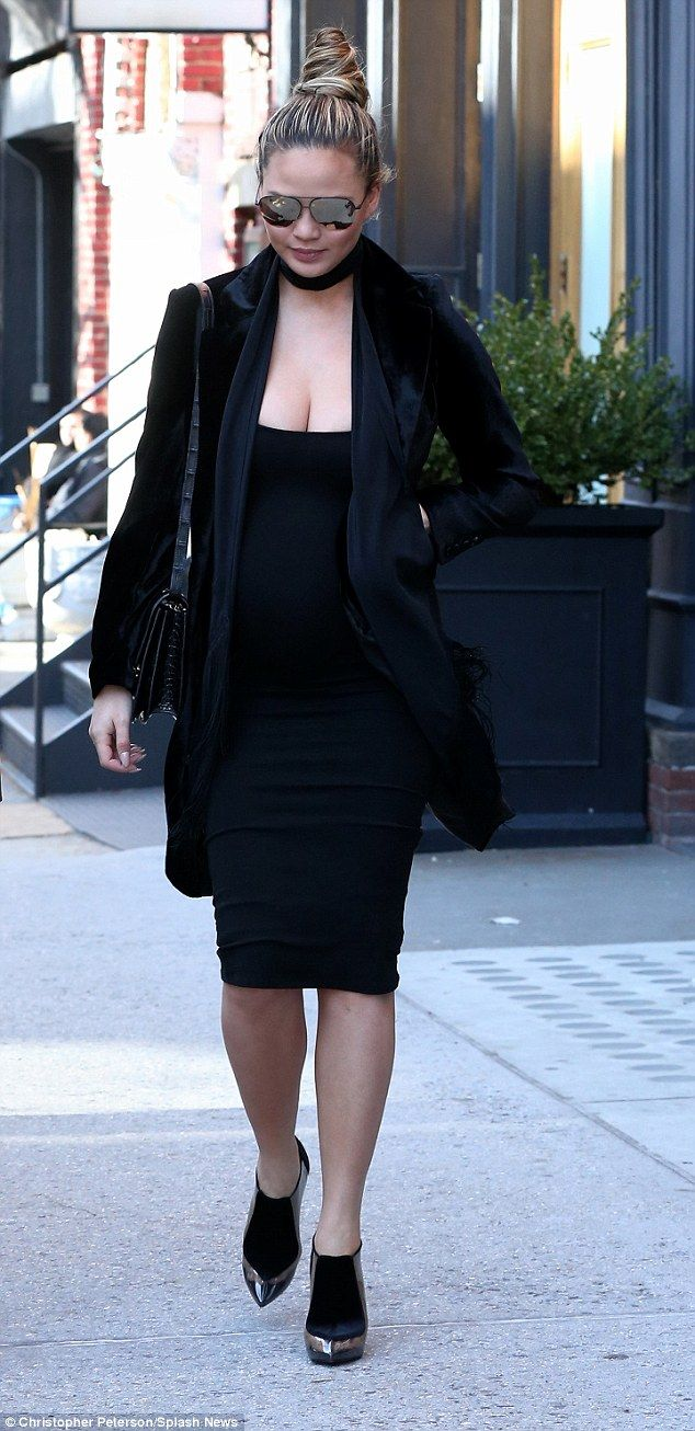 Blue black dress daily mail - Pregnant Chrissy Teigen Displays Baby Bump In Figure Hugging Dress