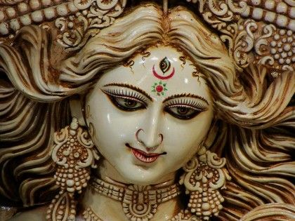 Durga gaze - like the softness to her expression and the distinctness of 3rd eye.