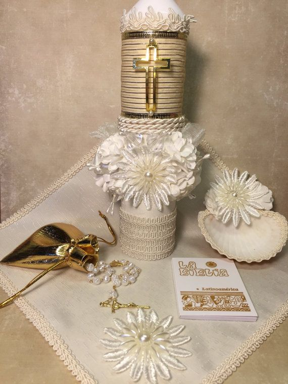 Hand crafted Baptism candle set. Ivory/Gold This set is all hand Crafted. Includes decorated candle 9x3, rosary in elegant pouch, shell (faux) 3 , small blanket 9 x 10 for drying babys head, and book of prayers (In Spanish) Set comes in a white bottom-clear lid box Juego de Vela de Bautizo