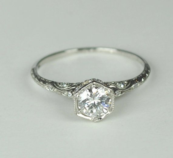 Wow, this is beautiful.   Definitely wanting an art deco style engagement ring..