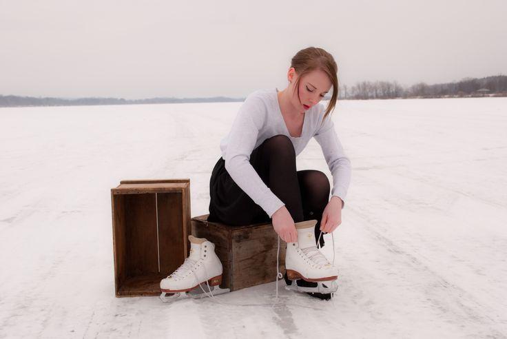 skating on frozen lake-senior picture