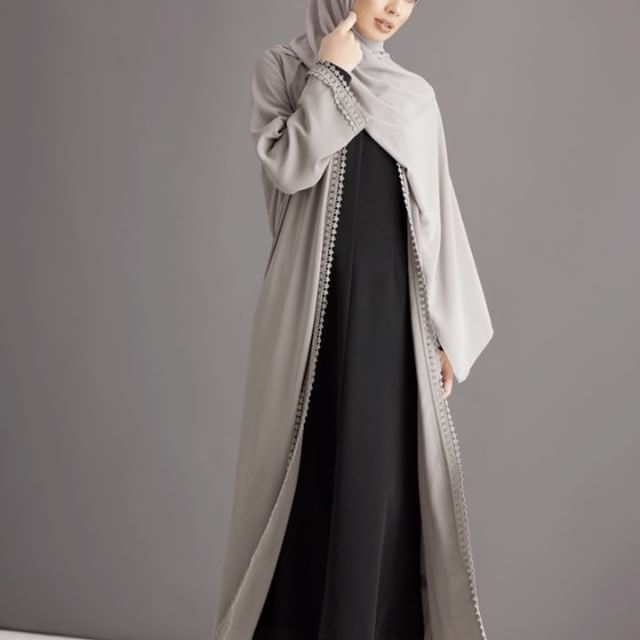 A hint of vintage chic and timeless hues, flawlessly cut from quality fabrics to create long and languid silhouettes. Silver Grey Lace Trimmed Kimono Mocha Kimono with Contrast Lace Trim Black Cascade Kimono Black Ramie Kimono with Lace www.inayah.co