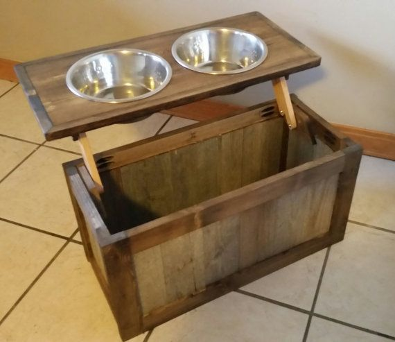 Wood dog feeder with bowls. I use reclaimed wood along with 3/4 inch pine to hand craft this unique piece. I use min wax and several coats of