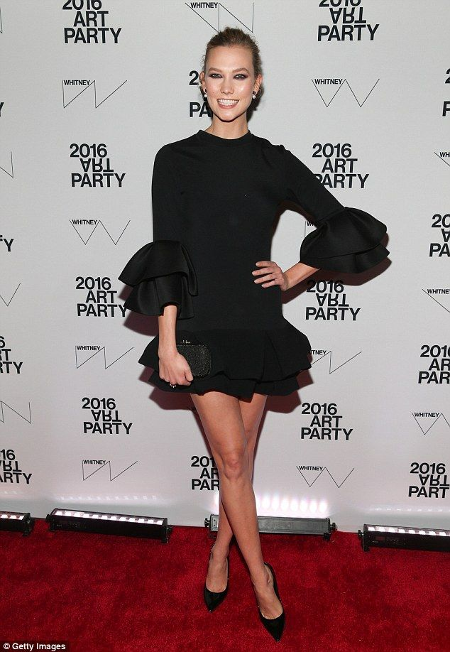 Tutu beautiful: Karlie Kloss wore a ballerina-inspired black mini dress and a big smile as she headlined a benefit gala at the Whitney Museum of American Art in NYC Tuesday night