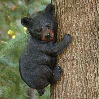 Our playful bear cub statue with big brown eyes and shiny black nose will be a big hit in your yard or garden! Realistically sculpted of durable weather resistant resin, it measures 13-3/4 long x 8 wide. Easily hangs with included bracket to fit your own nail or screw.