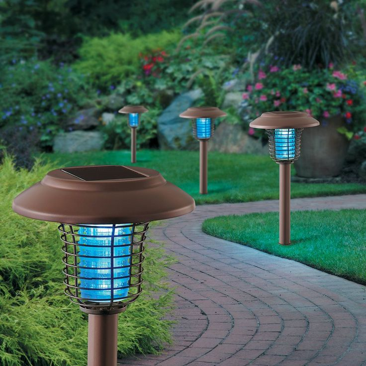 "Say ""so long"" to pests with this set of 2 solar bug zappers. Attractive and functional, they give your landscape the best of both worlds. Easily switch between solar light (white LED bulbs) and bug zapper (purple light LEDs) modes with this duo. Each covers up to 800 sq. ft. and stakes to the ground for easy installation. Available in two stylish finishes: Remington bronze and stainless steel. Choose multiple sets to line an entire walkway or driveway."