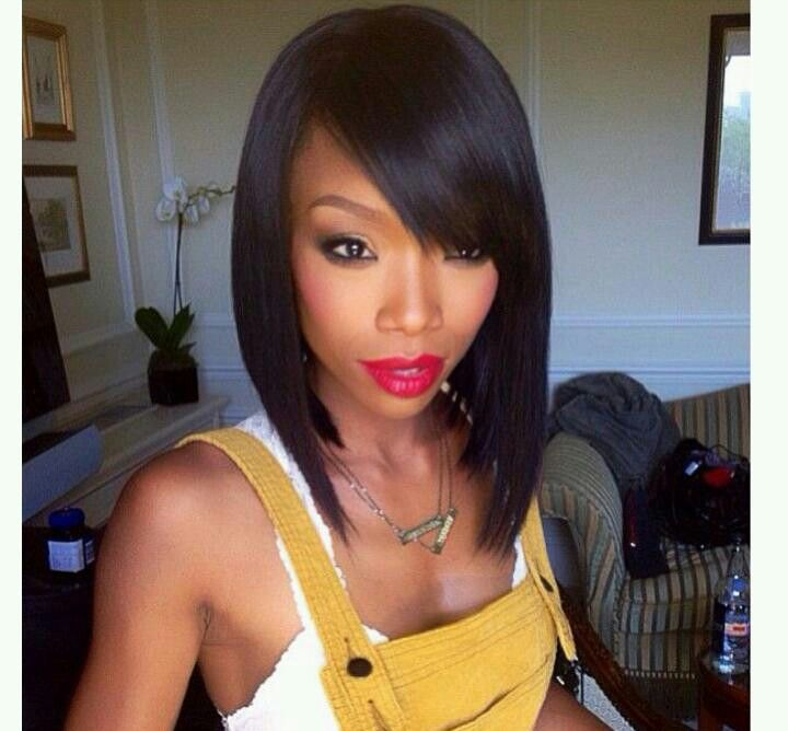 Brandy I'm so used to seeing her with box braids down to her waist, but I have to say she is rocking this look! I'm loving the smoothness and the side swept bangs. Very cute and sophisticated at the same time!