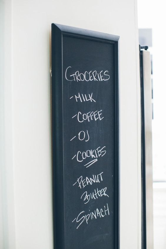 Hang a framed chalkboard to organize everything from shopping lists to schedules.: