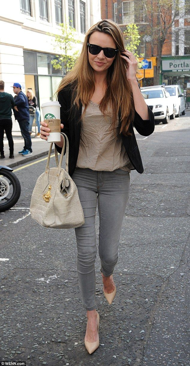 Toned down look: Nadine Coyle stepped out in London on Friday morning wearing a casual ens...