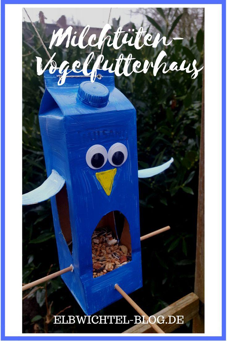 Vogelfutterhaus aus Milchtüten oder Tetra Pak. Basteln und Recyclen mit Kindern im Winter.