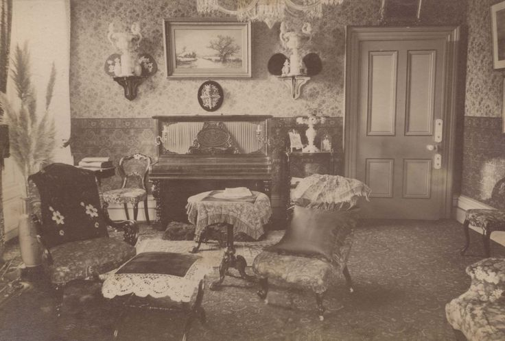 """Interior of Penlee House, c.1890"" ""Penlee House was built in 1865 for the wealthy Penzance miller and merchant, John Richards Branwell. [...] Penlee House originally contained three reception rooms, a dining room, breakfast room and drawing room, with a scullery kitchen, butler's pantry, dairy and office.  The first floor was approached by a formal staircase from the hall which is still in existence, and via a servants' staircase.  There were three main bedrooms"""
