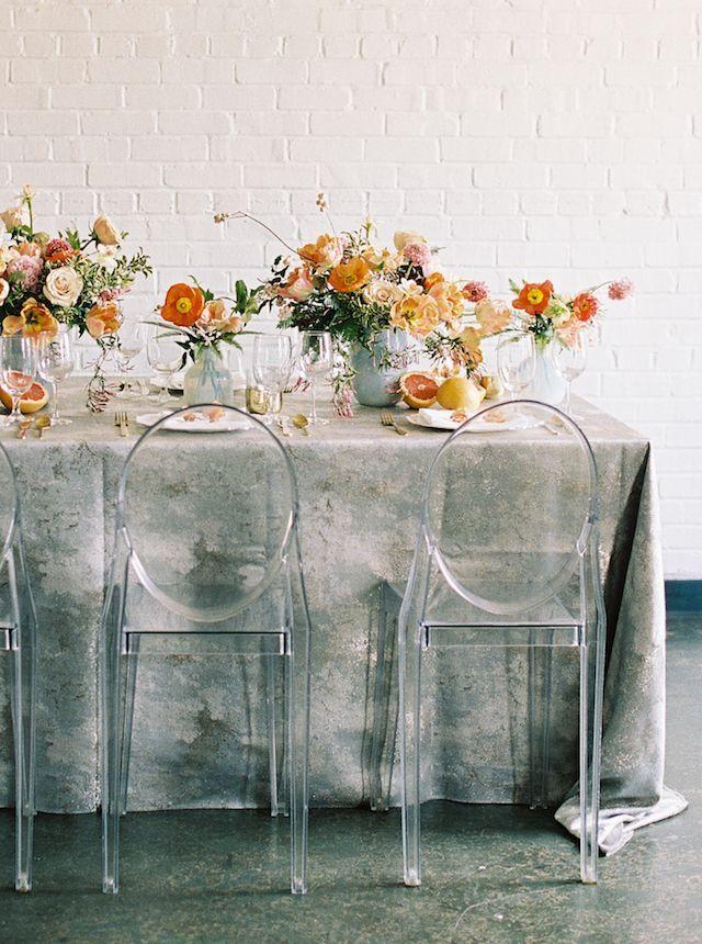 Citrus fruits and bright citrus colored poppy tablescape and centerpiece designs.