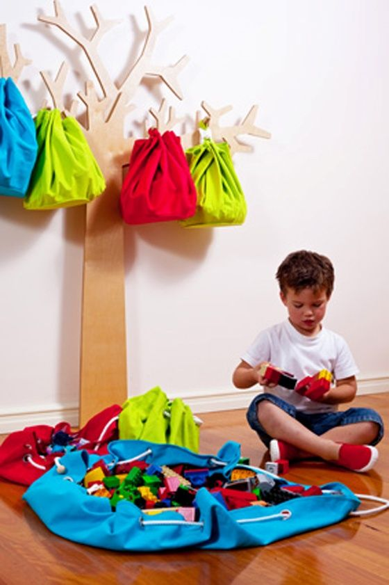 Such a fantastic edition to the kids playroom! Tree design with storage sacks doubles as art