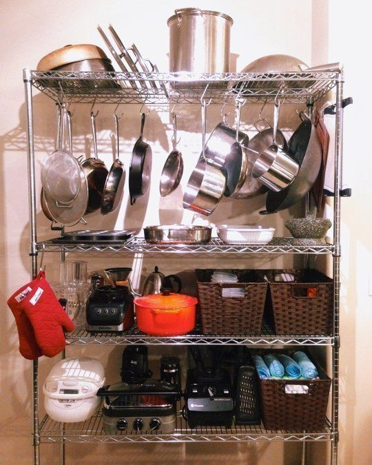 7 Organizing Accessories For the Wire Shelf In Your Kitchen - S- hooks help shelving double as a pot rack. Via IKEA.