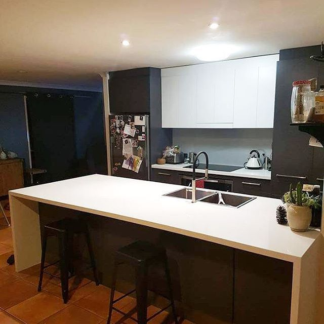 Heres a customers photo of their kitchen with a Smartstone Astral colour benchtop with undermount sink, glass splashback and melamine panels! Absolutely love it! #vertokitchens #kitchensbyverto #happycustomer #smartstone @smartstoneaustralia