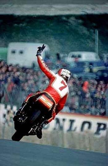 Sheene gives a V-sign to the crowd