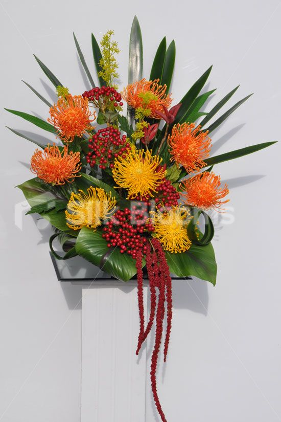 Stunning Artificial Protea Red And Orange Firework Arrangement W Orchid Leaves Modern Flower Arrangements Orchid Leaves Artificial Flowers Wedding