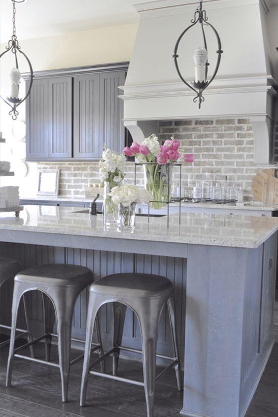 Kitchen with Aidan Gray Light Pendants Brick Backsplash
