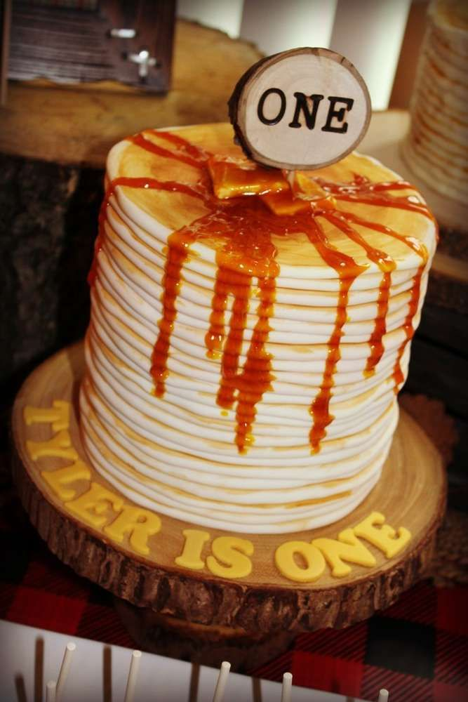 Amazing pancake cake at a lumberjack birthday party! See more party planning ideas at CatchMyParty.com!