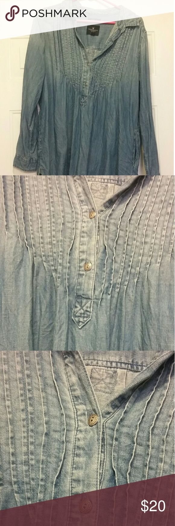 American Eagle denim tunic/blouse Denim. Long sleeved. With pockets. Buttons half way on the upper half of blouse. Cute with black jeans. Long enough to wear with leggings. American Eagle Outfitters Tops Tunics