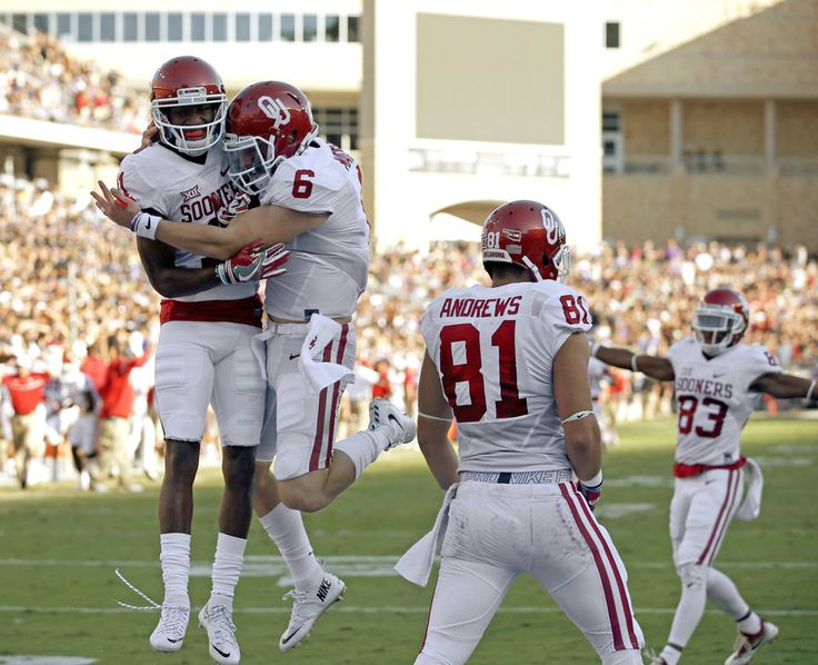 Oklahoma's Dede Westbrook (11) and Baker Mayfield (6) celebrate after scoring a touchdown during a college football game between the University of Oklahoma Sooners (OU) and theTCU Horned Frogs at Amon G. Carter Stadium in Fort Worth, Texas, Saturday, Oct. 1, 2016. Oklahoma won 52-46. Photo by Bryan Terry, The Oklahoman
