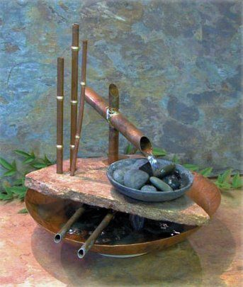 Provide your dwelling the beauty of flowing water using the Lotus Well Table Fountain from Exalted Fountains. The Lotus Well offers a unique design which includes a handmade copper bowl and piping and cast stone.