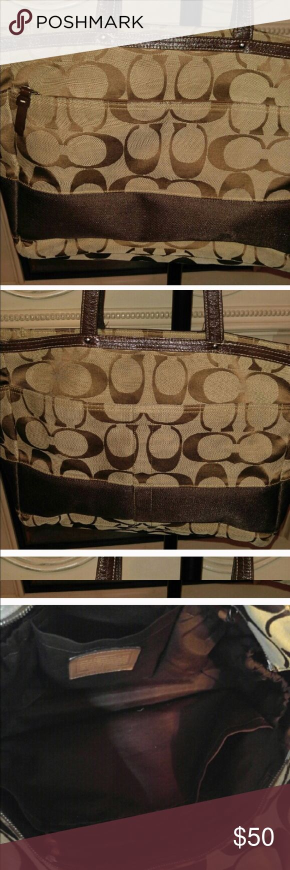 Large COACH TOTE This purse can hold everything and has several compartments.  Good condition Coach Bags