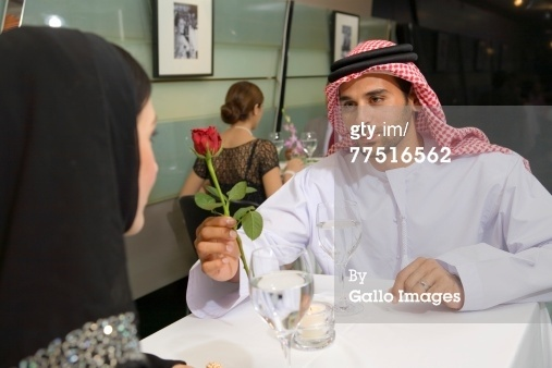 Arab Husband Offers Red Rose To Wife At Restaurant… Royalty-free Image | Getty Images | 77516562