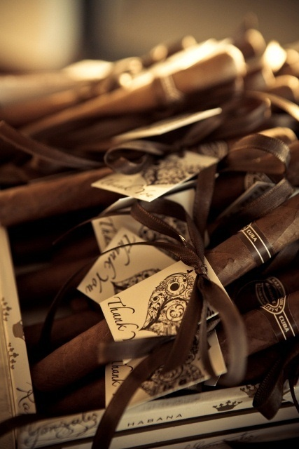 Cigars wrapped with thank you notes make sure guests celebrate your big day in sophisticated style!