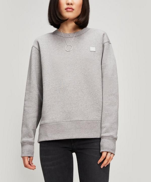 Acne Studios' Fairview Face sweat takes on a classic athletic silhouette with distinct detailing. Crafted from cotton, the style features a ribbed crewneck – finished with a face patch logo on the chest. Team it with trousers and trainers for a laid-back urban look.