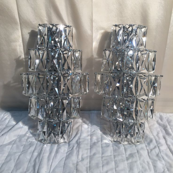 A personal favourite from my Etsy shop https://www.etsy.com/listing/462662464/set-of-two-large-crystal-glass-sconces