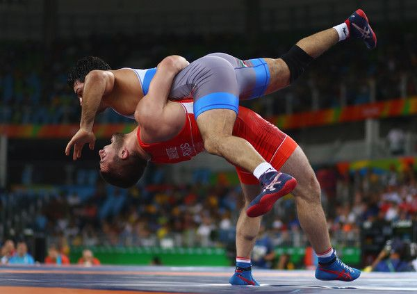 Habibollah Jomeh Akhlaghi Photos Photos - Davit Chakvetadze of Russia competes against Habibollah Jomeh Akhlaghi of Iran during the Men's Greco-Roman 85 kg on Day 10 of the Rio 2016 Olympic Games at Carioca Arena 2 on August 15, 2016 in Rio de Janeiro, Brazil. - Wrestling - Olympics: Day 10