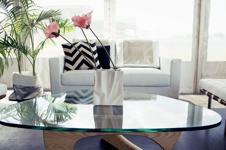 Townsville Amateurs event featuring our Noguchi coffee table, Knoll lounge and white vase http://www.edeevents.com.au/glass-noguchi-coffee-table