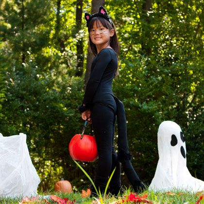 With a few fashion basics and materials you probably already have lying around the house, you can make a purrrfectly simple homemade cat costume for kids.
