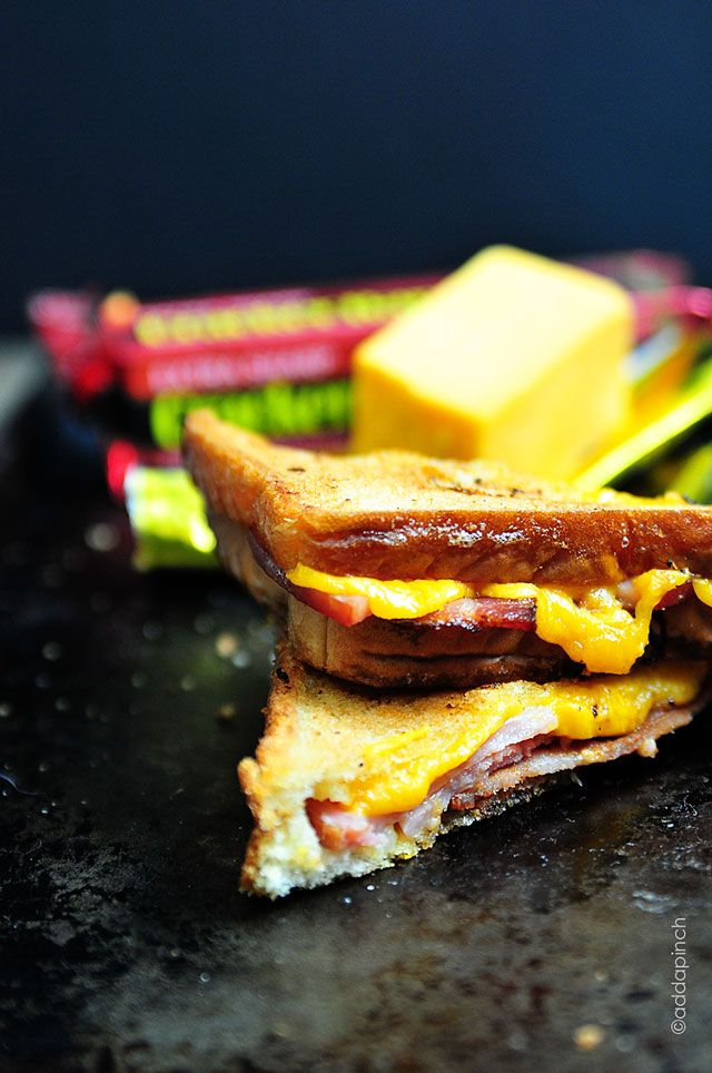 Grilled cheese sandwiches make a delicious comfort food. Get this Grilled Cheese Sandwich with Ham and Bacon recipe for a new favorite. #crackerbarrelcheese