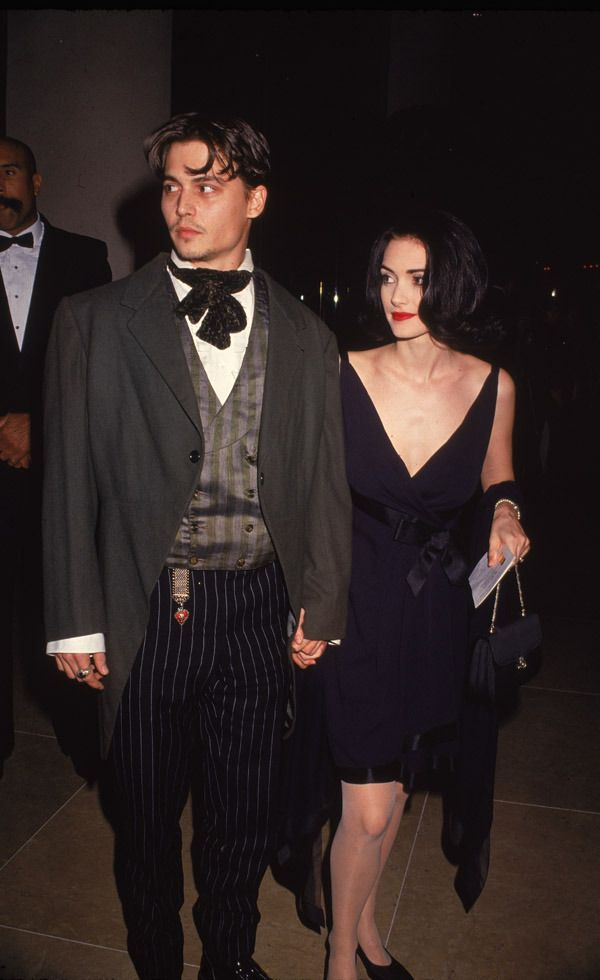 Winona Ryder's 12 Best '90s Outfits - Ryder wore this ladylike black dress, classic black pumps, and Chanel bag out one night with then-boyfriend Johnny Depp, finishing off her outfit with the perfect red lip. Can we say fashion perfection here, or what?