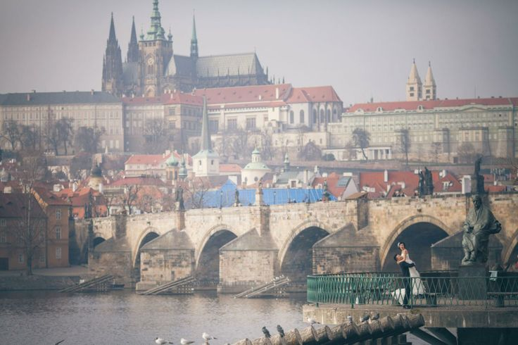 Suki & Steven's beautiful pre wedding portraits in Prague atop the world famous Charles Bridge by American Photographer Kurt Vinion