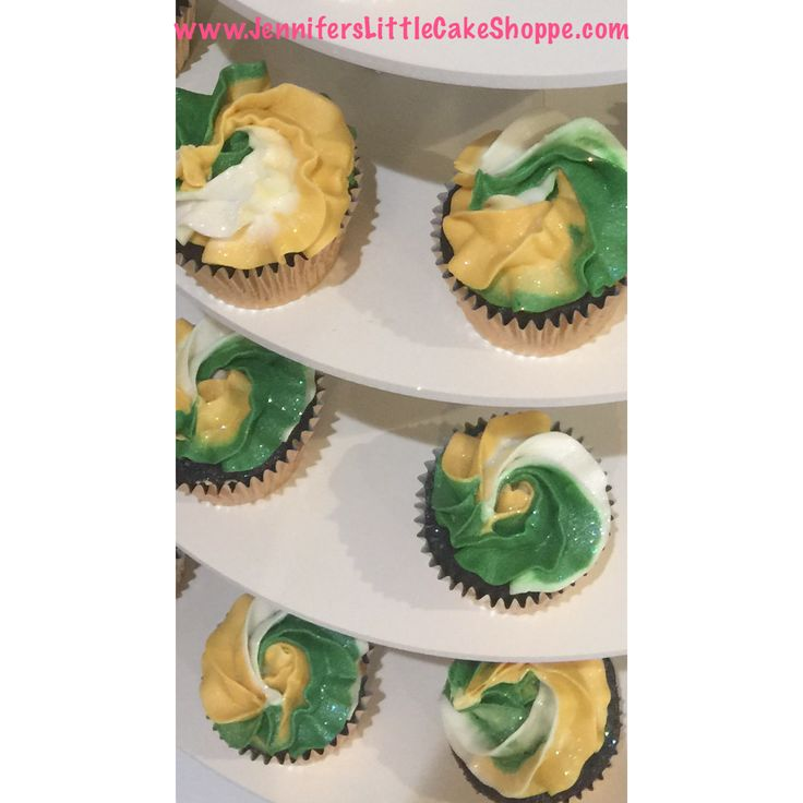 Cupcakes for Fleming Island High School Cheerleader Banquet- chocolate and vanilla with green, gold and white swirl buttercream icing from Jennifer's Little Cake Shoppe in Fleming Island, Florida- www.JennifersLittleCakeShoppe.com