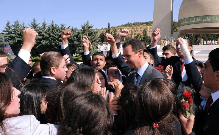 Syrian President Bashar al-Assad is greeted by children of soldiers during a ceremony to mark Martyrs' Day at the Tomb of the Unknown Soldier in Damascus May 6, 2011. UPI/Handout..