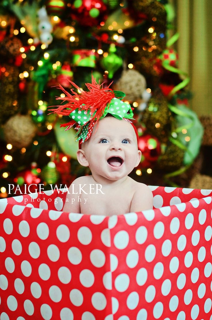 Cute baby Christmas photo.  This would be so cute with the baby in it next year!!