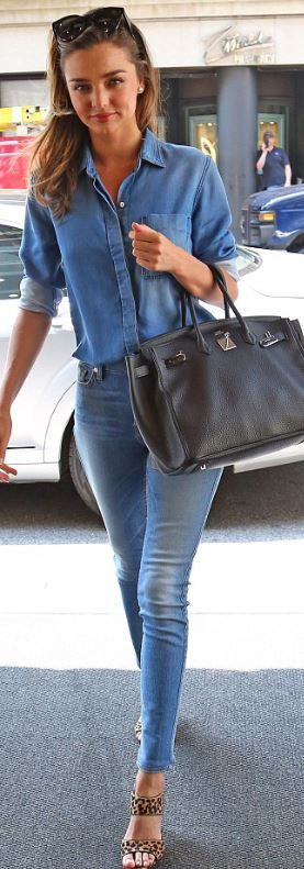 Who made  Miranda Kerr's blue skinny jeans, denim button down shirt, black sunglasses, tote handbag, and leopard print sandals that she wore in New York?