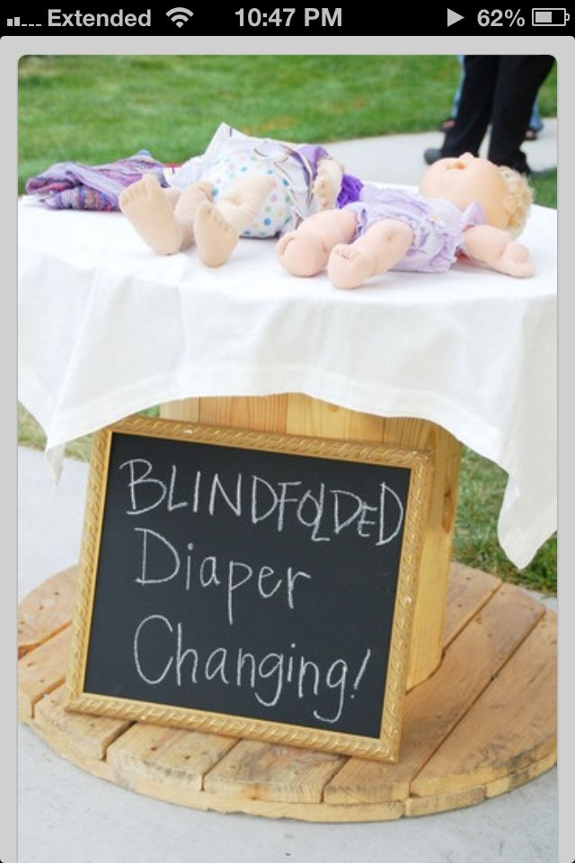 Baby shower game.Dirty diaper changing table.Diposable diapers loaded -w-mustard &green relish.Quick!!! Change diaper before timer goes off!